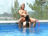 Three hot lesbians playing dirty in the pool