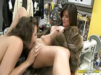 Lesbians having sex in clothes shop