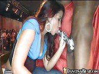 Horny babe sucks a black dick on the stage