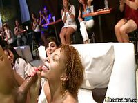 Horny ladies sharing cock in a club