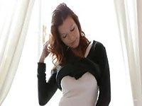 Seductive natural redhead stripping