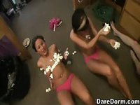 Dirty college girls stripping down to their panties and less to lick whip cream off each other