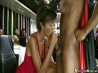 Beautiful ebony woman gives head to male stripper