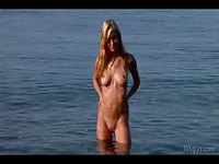 Hot naked blonde in the water