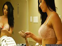 Black haired prostitute getting ready for her client