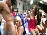 Male stripper having some fun with lonely women at party