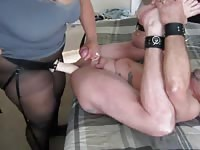 Chunky older whore in pantyhose pegging her husband's anal cavity with a strapon