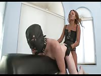 Masked submissive middle-aged guy getting anal pegged by a strapon wearing MILF