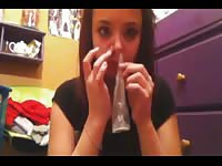 Bizarre webcam video as an eighteen year old girl sucks a condom through her nose on cam