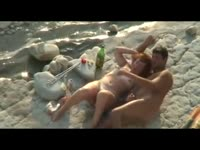 Redhead older whore getting finger fucked and probed on a nude beach by her horny partner