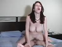 Bodacious college slut Dawn teases herself with cock before riding topless reverse-cowgirl