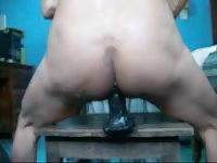 Hairy gay adores riding on a big rubber dildo in the living room