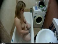 Awesome hidden camera footage that captured unsuspecting chubby whore showering nude