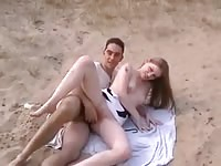 Pretty nineteen year old shows her adventurous side as she gets fucked on the beach by dude