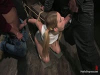 Eighteen year old Aly satisfying a horde of ten well-endowed men while helpless in restraints