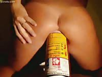Amateur girl riding a giant bottle in her butt hole