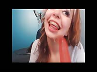 Playful redhead amateur webcam model gagging herself with a large dildo during live show